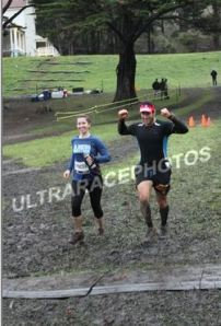Crossing the finish line at last year's muddy race.