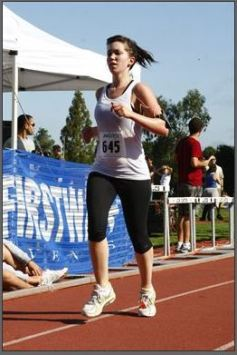 Kaiser doesn't have their photos from 2011 posted anymore, so here's a photo of my first race ever, the Jungle Run Half Marathon. It would take a few years until I graduated from cotton tank tops.