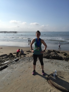Posing in front of the ocean post-race.